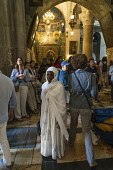 Israel, Jerusalem, An Ethiopian Christian pilgrim visiting the Church of the Holy Sepulchre in the Christian Quarter of the Old City of Jerusalem. The Old City of Jerusalem and its Walls is a UNESCO W...