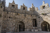 Israel, Jerusalem, The rampart over the Damascus Gate in the Old City. The Damascus Gate is one of three gates through the north wall of the Old City. The Old City of Jerusalem and its Walls is a UNES...
