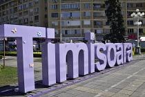 Romania, Timis, Timisoara, sign and gardens, Piata Victoriei, old town.