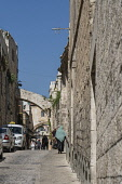 Israel, Jerusalem, Lions' Gate Street in the Muslim Quarter of the Old City of Jerusalem. The Old City and its Walls is a UNESCO World Heritage Site. The Ecce Homo Arch, with the window, is visible ov...