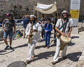 Israel, Jerusalem, Jewish Quarter, Musicians lead the procession before a bar mitzvah ceremony in the Jewish Quarter of the Old City. The Old City of Jerusalem and its Walls is a UNESCO World Heritage...