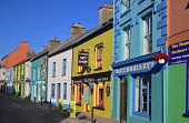 Ireland, County Kerry, Dingle, Evening shadows on a colourful row of houses on Strand Street.