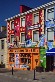 Ireland, County Clare, Lisdoonvarna, Colourful romance based artwork surrounding the Matchmaker Bar relating to the towns annual Matchmaker festival held every September.