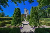 Ireland, County Clare, Quin, Knappogue Castle seen from the walled Rose Garden.