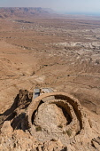 Israel, The middle terrace of the Herod's Northern Palace at Masada contained a circular reception hall with a pointed roof supported by columns. Ruins of the fortress of Masada in the Judean Desert o...