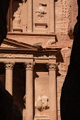 Jordan, Petra, The first view of of the ruins of Al Khazneh or the Treasury in the narrow slot canyon called the Siq which leads to the ruins of the Nabataean city of Petra in the Petra Archeological...
