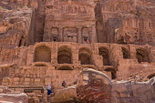 Jordan, Petra, Tourists on the stone arches and stairways below the Urn Tomb, a Royal Tomb in the ruins of the Nabataean city of Petra in the Petra Archeological Park in the A UNESCO World Heritage Si...
