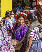 Guatemala, Solola Department, Santiago Atitlan, Older Mayan women in traditional dress in the weekly open market.  One woman wears the tocoyal head wrap characteristic to this town.  It was once commo...