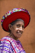 Guatemala, Solola Department, Santiago Atitlan, An older Mayan woman wears traditional dress, including a tocoyal or head wrap.  They are a symbol of status and authority for a woman.Twenty-five years...