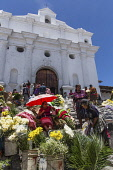 Guatemala, El Quiche Department, Chichicastenango, Vendors sell flowers on the steps of the Church of Santo Tomas. The church was built about 1545 A.D. on the platform of a Mayan pyramid.