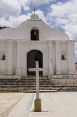Guatemala, Solola Department, Santa Cruz la Laguna, A small, simple Catholic church with a cross on the plaza or town square in front.