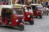 Guatemala, Solola Department, San Pedro la Laguna, A line of mototaxis wait for passengers by the boat dock. Mototaxis or tuk tuks from India are a very economical form of public transportation in muc...
