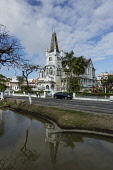 Guyana, Demerara-Mahaica Region, Georgetown, The old City Hall built of timber and completed 1889 in the Danube Gothic style.  It is no longer the city hall and has fallen into disrepair.