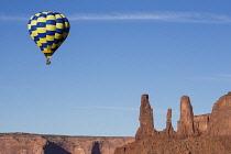 USA, Arizona, Monument Valley, Hot air balloons in the Monument Valley Balloon Festival in the Navajo Tribal Park.