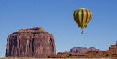 USA, Arizona, Monument Valley, Hot air balloon flying by Merrick Butte during Balloon Festival in the  Navajo Tribal Park.