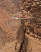 USA, Utah, Moab, Base jumpers prepare to jump from the Mothership Spacenet suspended from the cliffs 950 vertical feet above the valley floor at Mineral Canyon.