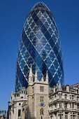 England, London, The Swiss Re building 30 St Mary Axe, alternatively known as the Gherkin, commercial skyscraper designed by architect Sir Norman Foster and opened in April 2004 with St Andrew Undersh...