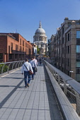 England, London, City workers crossing the Millennium Bridge towards St Paul's Cathedral.