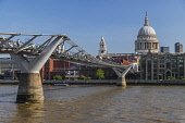 England, London, Early morning view of the Millennium Bridge and the River Thames looking towards St Paul's Cathedral.