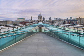 England, London, Early Sunday morning view of a quiet Millennium Bridge and the River Thames looking towards St Paul's Cathedral.
