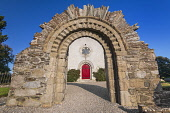 Republic of Ireland, County Kildare, Castledermot, Romanesque doorway in front of St James Church which is Church of Ireland.
