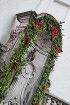 Belgium, Brussels, Manneken Pis with Christmas decoration surrounding it.