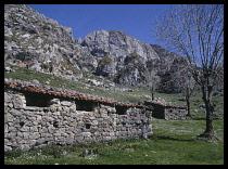 Spain, Asturias, Montana de Covadonga National Park  Sheperds Shelter  Stone built sheds with tiled roof.