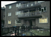 Scotland, Glasgow, Easter House flats with smashed boarded up windows.