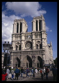 France, Ile de France , Paris, Notre Dame Cathedral  exterior facade with crowds of people in foreground.