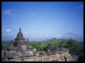 Indonesia, Java , Central, Borobudur Temple ruins, Buddhist monument constructed in the early 9th century AD, Mount Merapi in the distance.