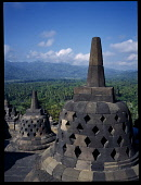 Indonesia, Java, Central, Borobudur Temple ruins.  Buddhist monument constructed in the early 9th century.  Latticed stupas on the upper circular terraces.
