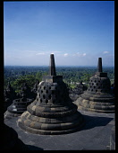 Indonesia, Java , Central, Borobudur Temple ruins, Buddhist monument constructed in the early 9th century latticed stupas on the upper circular terraces.