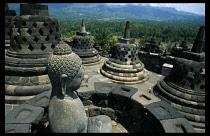 Indonesia, Java, Java Island, Seated Buddha at Borobudur temple complex
