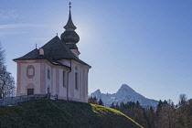 Germany, Bavaria, Maria Gern village near Berchtesgaden,  Pilgrimage Church of Maria Gern., rear view with the Watzmann Mountain in the background.
