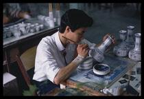 China, Wuxi, Jiangsu, Painting porcelain vase.
