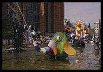 France, Ile de France, Paris, Pompidou Centre, Exterior with colourful artwork incorporating fountains.