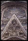 France, Normandy, Seine-Maritime, Rouen, Detail of stonework and window on the Cathedral exterior.