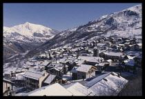 France, Savoie, St Martin de Belleville, Snow covered hillside town.