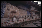 China, Sichuan , Dazu, Large reclining Buddha with line of smaller figures along its side. .