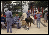 China, Yanan, Chinese tourists dressing up as Red Guards or Communists, at a tourist site.