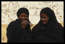 Egypt, Aswan, Portrait of two Nubian women in tradional dress.