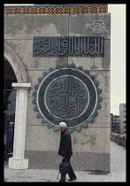 China, Yinchuan, Muslim man on his way to Mosque.