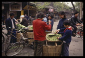 China, Chengdu, Peas for sale on market stall.