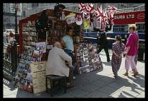 England, London, Picadilly Circus souvenir vendor.