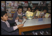 Egypt, Cairo, Childrens studying in library at state school.