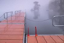 Ireland, County Sligo, Sligo town, Doorly Park, Boardwalk on the River Garavogue on a foggy winter morning.