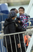 England, Kent, Dover, Border Force officers landing Asylum Seekers picked up in the English Channel.