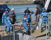 England, Kent, Dover, Coast Guard Rescue officers landing injured Asylum Seekers picked up in the English Channel.
