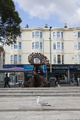 England, East Sussex, Brighton, Norfolk Square, Waves of Compassion Sculpture created by Steve Geliot, formed of three original Old Steine dolphins, which were designed by Amon Henry Wilds as part of...