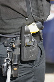 Law & Order, Crime, Police, Detail of police officers belt with handcuffs etc.